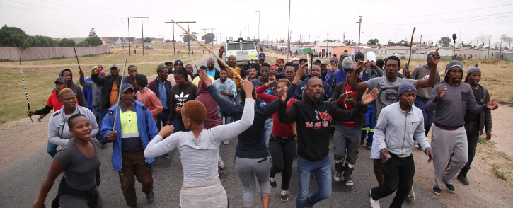 Angry Vredenburg residents march to the town's municipal offices on 14 November 2018 in protest over a lack of housing and poor service delivery. Picture: Bertram Malgas/EWN