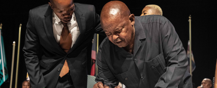 Cope's Mosiua Lekota signs the IEC code of conduct. Picture: Abigail Javier/EWN