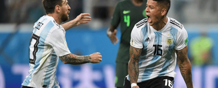 Argentina's defender Marcos Rojo (R) celebrates his goal with Argentina's forward Lionel Messi during the Russia 2018 World Cup Group D football match between Nigeria and Argentina at the Saint Petersburg Stadium in Saint Petersburg on 26 June, 2018. Picture: AFP.