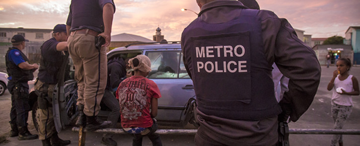 Members of Cape Town's Gang and Drug Taskforce stop and search suspects in Manenberg. Picture: Thomas Holder/EWN.