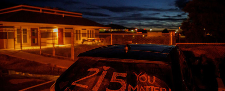 A message honouring the 215 children whose remains were discovered buried in unmarked graves near the former Kamloops Indian Residential School, in Kamloops, Canada, on 5 June 2021. Picture: Cole Burston/AFP