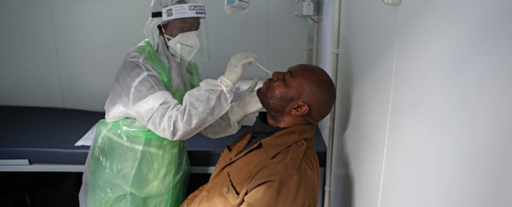 FILE: A City of Tshwane Health official takes a nasal swab to test for the COVID-19 coronavirus on a taxi operator at the Bloed Street Mall in Pretoria Central Business District, on 11 June 2020. Picture: AFP