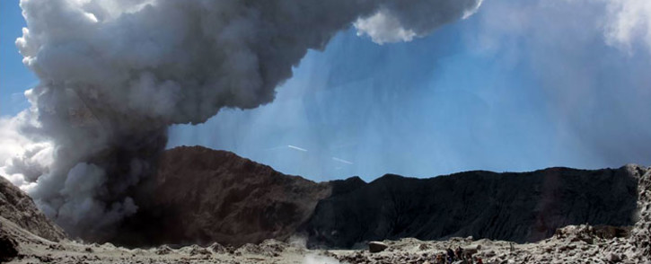 This handout photograph courtesy of Michael Schade shows the volcano on New Zealand's White Island spewing steam and ash minutes following an eruption on 9 December 2019. Picture: AFP