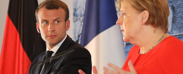 FILE: French President Emmanuel Macron (L) and German Chancellor Angela Merkel. Picture: AFP.