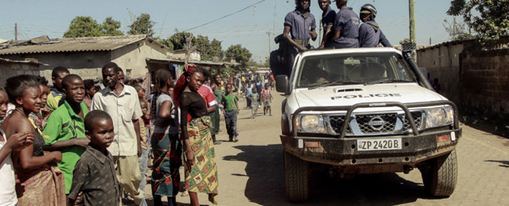 FILE. Zambian Police patrol near the Chawama Compound where residents have attacked broken and looted foreign-run shops in Lusaka on 19 April, 2016. Picture: AFP.