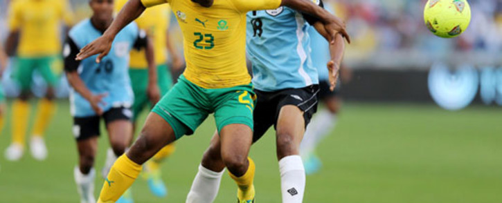 Bafana Bafana's Tokelo Rantie vies with Botswana's Mogogi Gabonamong during a 2014 Soccer World Cup Qualifying match at The Moses Mabhida Stadium in Durban on 7 September 2013. Picture: AFP/ANESH DEBIKY