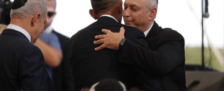 President Barack Obama, centre, greets Chemi Peres, the son of former Israeli president Shimon Peres, next to Israeli PM Benjamin Netanyahu, left, during Peres' funeral at Jerusalem's Mount Herzl national cemetery. Picture: AFP.