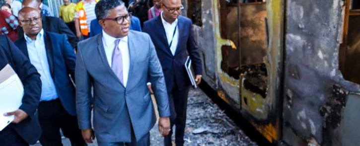Transport Minister Fikile Mbalula on 28 November 2019 visited Cape Town Train Station after 18 train carriages were destroyed in a fire. Picture: @MbalulaFikile/Twitter