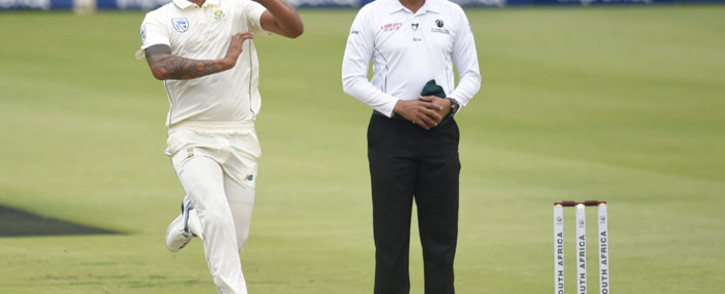 FILE: South Africa's Beuran Hendricks (L) delivers a ball as umpire Joel Wilson looks on during the first day of the fourth Test cricket match between South Africa and England at the Wanderers Stadium in Johannesburg on 24 January 2020. Picture: AFP