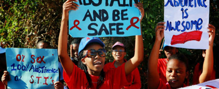 """FILE: Students participate in an """"Abstinence Walk"""" to commemorate Women's Day in Durban on Thursday, 9 August 2012. Picture: Sapa."""