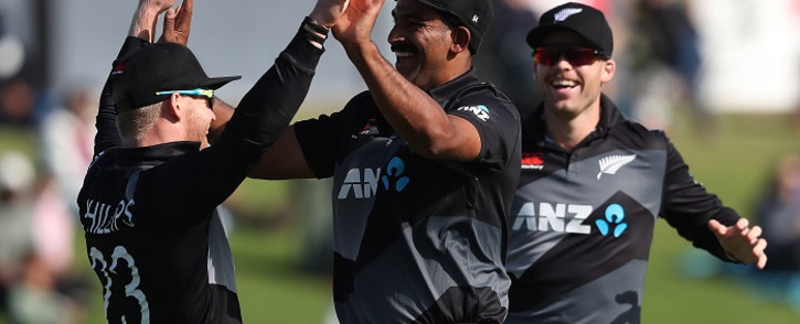 (L-R) New Zealand's Glenn Phillips, Ish Sodhi and Lockie Ferguson celebrate the wicket of West Indies Kyle Mayers during the second Twenty20 International cricket match between New Zealand and the West Indies at the Bay Oval in Mount Maunganui on November 29, 2020. Picture: AFP