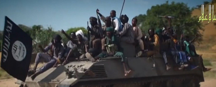 FILE: A screengrab taken on 9 November 2014, from a new Boko Haram video released by the Nigerian Islamist extremist group Boko Haram and obtained by AFP shows Boko Haram fighters parading on a tank in an unidentified town. Picture: AFP.