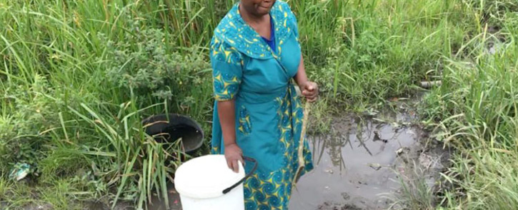 Sibongile Mthembu, a resident of Ejikeni in Ndwedwe, has had to collect water from contaminated ponds for eight years due to a lack of running water in the area. Picture: Nkosikhona Duma/EWN