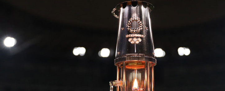 FILE: A lantern containing the Olympic flame is seen during an event to mark one year until the postponed Tokyo 2020 Olympic and Paralympic Games at the National Stadium in Tokyo on 23 July 2020. Picture: AFP