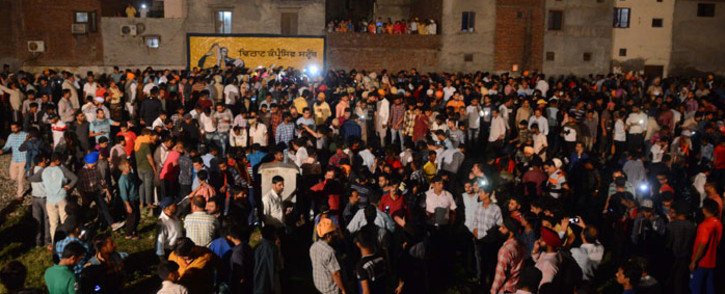 Indian relatives and revellers gather around the bodies of the victims of a train accident during the occasion of the Hindu festival of Dussehra in Amritsar on 19 October 2018. A train crashed into revellers gathered to watch the Hindu festival of Dussehra in the northern state of Amritsar, killing at least 50 people, the Press Trust of India news agency said. Picture: AFP