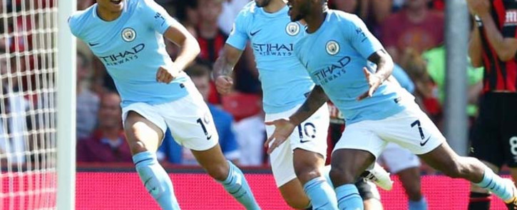 Raheem Sterling (right) celebrates after scoring Manchester City's second goal. Picture: @ManCity/Twitter.