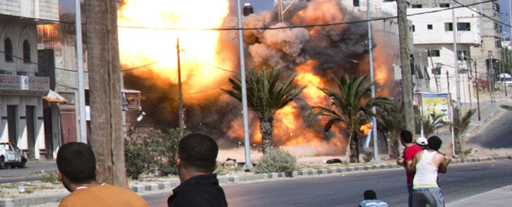 FILE: The pre-dawn airstrikes set off huge explosions, killed 2 and wounded 20 people. Picture: AFP.