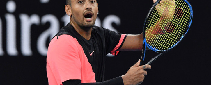 FILE: Australia's Nick Kyrgios speaks to the umpire during their men's singles second round match against Serbia's Viktor Troicki on day three of the Australian Open tennis tournament in Melbourne on 17 January 2018. Picture: AFP