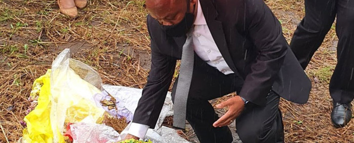 KwaZulu-Natal Premier Sihle Zikalala lays a wreath for the murder victims in uMthwalume on 1 September 2020. Picture: @kzngov/Twitter