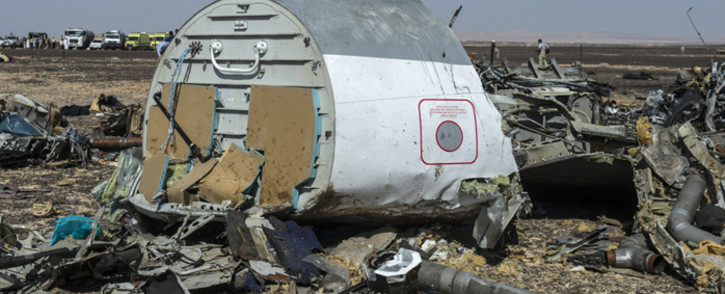 Debris of the A321 Russian airliner lie on the ground a day after the plane crashed in Wadi al-Zolomat, a mountainous area in Egypt's Sinai Peninsula, on 1 November, 2015. Picture: AFP.