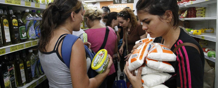 """Venezuelans shop for groceries at a supermarket in Cucuta, Colombia on August 13, 2016. T Venezuela and Colombia on Saturday opened several """"provisional"""" border crossing points for pedestrians for the first time in nearly a year as part of a progressive reopening agreed this week. Picture: AFP"""