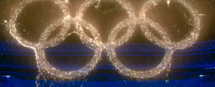 A display of beautiful, luminous colours swirl together, representing the many flags of the world. They form the Olympic Rings, a timeless symbol of unity. Picture: @Olympics/Twitter.