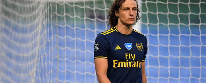 Arsenal defender David Luiz leaves the pitch after receiving a red card during the English Premier League football match between Manchester City and Arsenal at the Etihad Stadium in Manchester, north-west England, on 17 June 2020. Picture: AFP