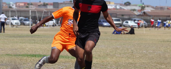 Ubuntu Football Academy's Uzayr Lee (foreground) controls the ball during a local football match. Picture: Supplied