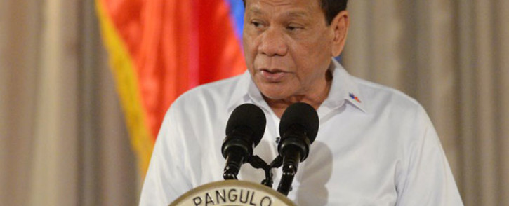 FILE: Philippine President Rodrigo Duterte delivers a speech during a ceremony for a proposed draft of the Bangsamoro Basic Law (BBL) at the Malacanang Palace in Manila on July 17, 2017. Picture: AFP