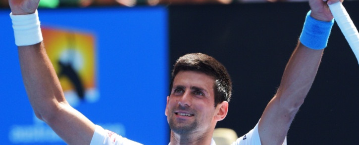 FILE: Serbia's Novak Djokovic celebrates after victory in his men's singles match against Russia's Andrey Kuznetsov on day four of the 2015 Australian Open tennis tournament in Melbourne on 22 January, 2015. Picture: AFP.
