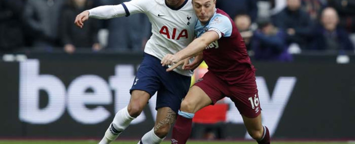 Tottenham Hotspur's English midfielder Dele Alli (L) vies with West Ham United's English midfielder Mark Noble during the English Premier League football match between West Ham United and Tottenham Hotspur at The London Stadium, in east London on 23 November 2019. Picture: AFP.