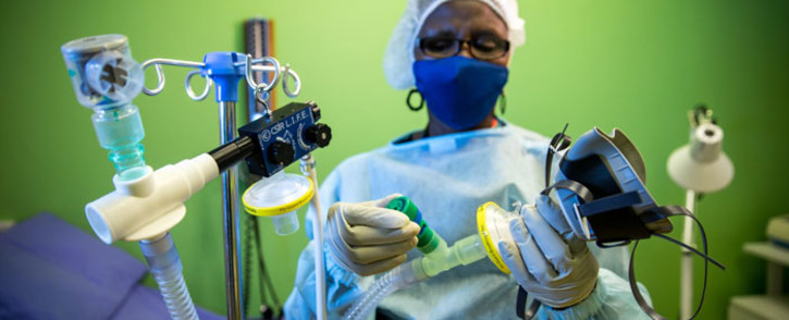 FILE: A nurse holds a South African designed non-invasive ventilator. Picture: CSIR.