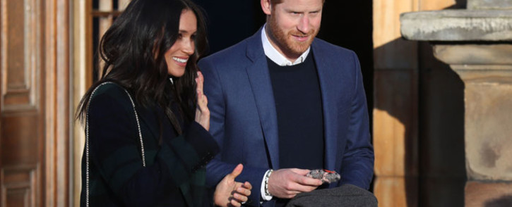 Britain's Prince Harry (R) and his fiancée US actress Meghan Markle leave a reception for young people in the Palace of Holyroodhouse in Edinburgh, during their visit to Scotland on 13 February, 2018. Picture: AFP