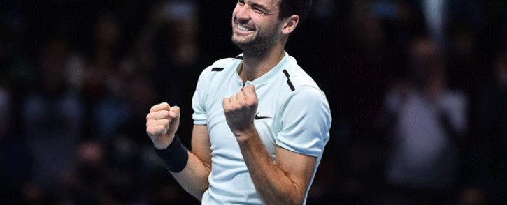 Bulgaria's Grigor Dimitrov celebrates winning his men's singles final match against Belgium's David Goffin on day eight of the ATP World Tour Finals tennis tournament at the O2 Arena in London on 19 November 2017. Dimitrov won the match 7-5, 6-4, 6-3. Picture: AFP.