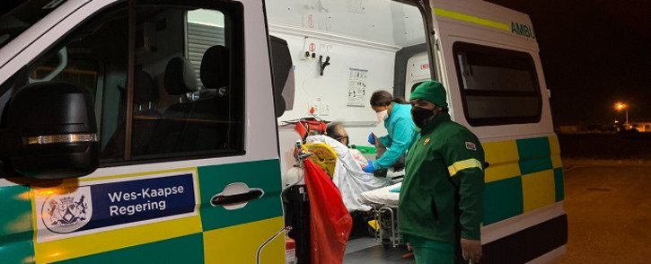 Paramedics attending to a patient in Tafelsig. There are concerns around the increasing number of attacks on emergency crews in the Western Cape. Picture: Kaylynn Palm/EWN
