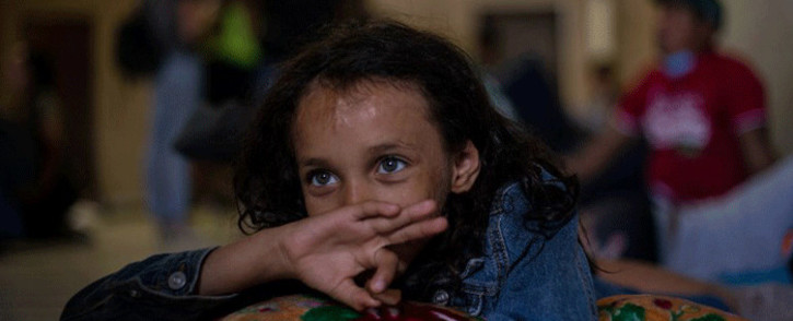 """Honduran Ashley, 8, rests at the Hotel Migrante shelter in Mexicali, Mexico, on 24 April, 2018, after arriving with other Central American migrants taking part in the """"Migrant Via Crucis"""" caravan. Picture: AFP"""