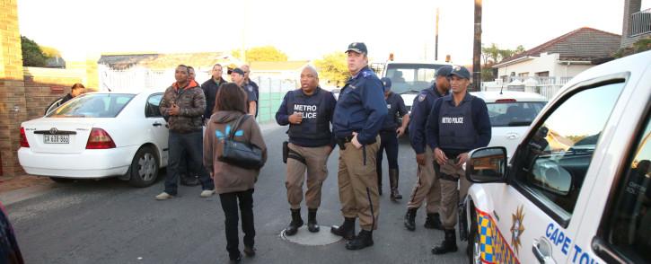 FILE: Metro Police gather in a Elsies River street. Picture: Bertram Malgas/EWN.