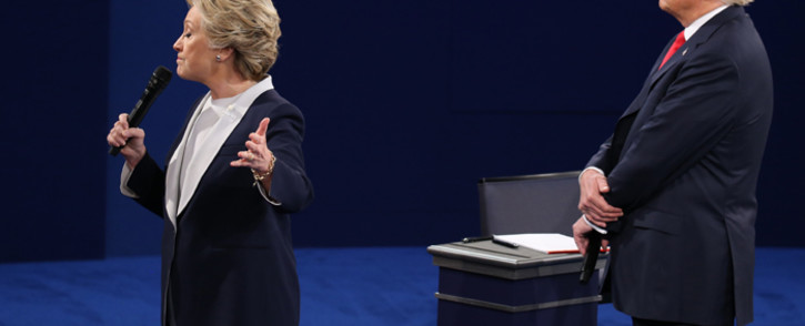 FILE: US Democratic presidential candidate Hillary Clinton and US Republican presidential candidate Donald Trump debate during the second presidential debate at Washington University in St. Louis, Missouri, on 9 October, 2016. Picture: AFP.
