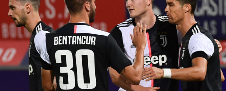 Juventus forward Cristiano Ronaldo (R) celebrates with defender Matthijs de Ligt (C) and midfielder Rodrigo Bentancur after scoring a penalty kick to open the scoring during the Italian Serie A football match Bologna vs Juventus on 22 June, 2020 at the Renato-Dall'Ara stadium in Bologna. Picture: AFP