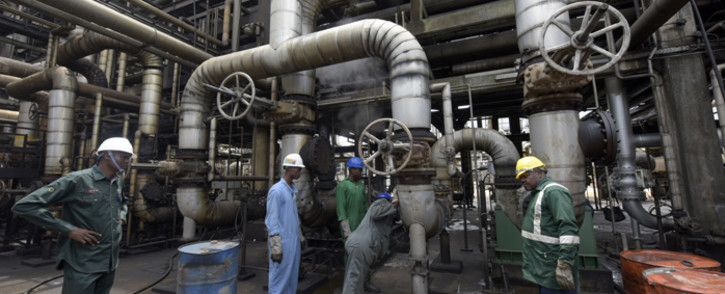 FILE: Workers rehabilitate the new Port Harcourt refinery built in 1989 at the same site where the first refinery in Nigeria was built in 1965 in oil rich Port Harcourt, Rivers State. Picture: AFP.
