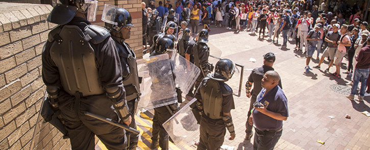 Private security was called in to assist at the University of the Western Cape on Monday 22 February 2016 when protesting cleaners attempted to start a fire. Picture: Aletta Harrison/EWN