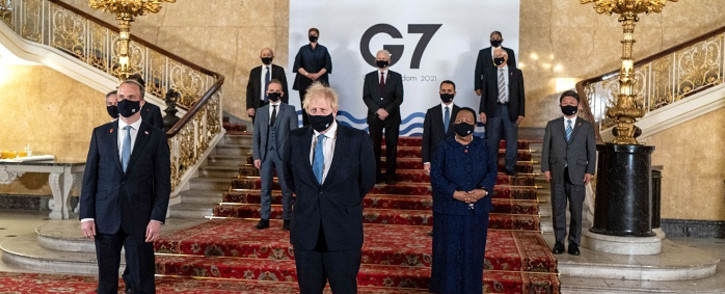 A handout picture released by the European Commission shows Britain's Prime Minister Boris Johnson (C) and Britain's Foreign Secretary Dominic Raab (2L), posing for a family photograph with other delegates during the G7 foreign ministers meeting in London on May 5, 2021. Picture: AFP