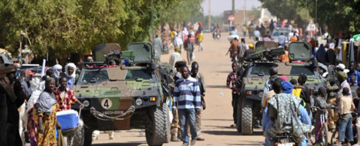 French troops patrol in the streets of Gao on February 3, 2013. France said it carried out major air strikes on the same day near Kidal, the last bastion of armed extremists chased from Mali's desert north in a lightning French-led offensive. Picture: AFP / Sia Kambou