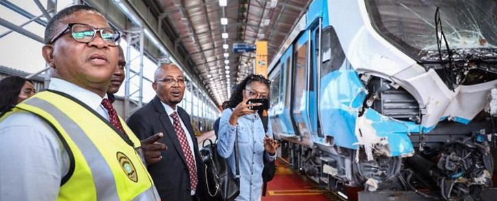 Transport Minister Fikile Mbalula inspects the train that was involved in the Eerste Fabrieke train station collision. Picture: Abigail Javier/EWN