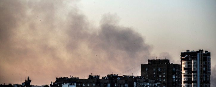 FILE: Smoke rises over Donetsk city as the conflict in Ukraine continues. Picture: AFP