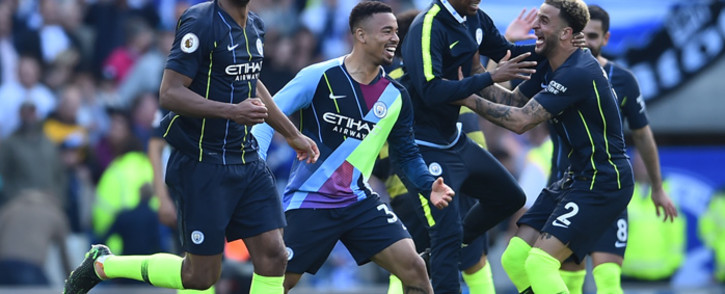 (L-R) Vincent Kompany, Gabriel Jesus, Fernandinho and Kyle Walker celebrate at the final whistle of the English Premier League football match against Brighton and Hove Albion at the American Express Community Stadium on 12 May 2019. Picture: AFP.