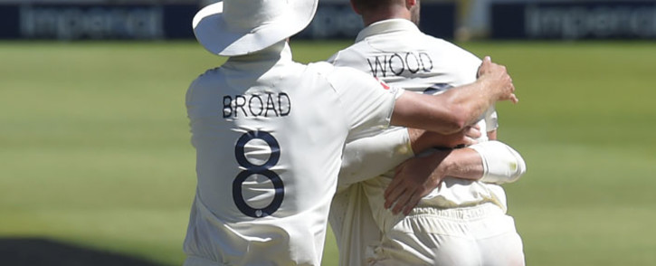 England's Stuart Broad (L) celebrates with teammate England's Mark Wood (R) after the dismissal of South Africa's Rassie van der Dussen during the fourth day of the fourth Test cricket match between South Africa and England at the Wanderers Stadium in Johannesburg on 27 January 2020. Picture: AFP