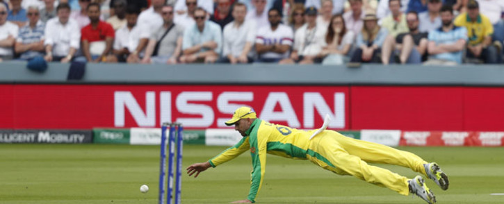 Australia's Nathan Lyon fields a ball during the 2019 Cricket World Cup group stage match between England and Australia at Lord's Cricket Ground in London on 25 June 2019. Picture: AFP
