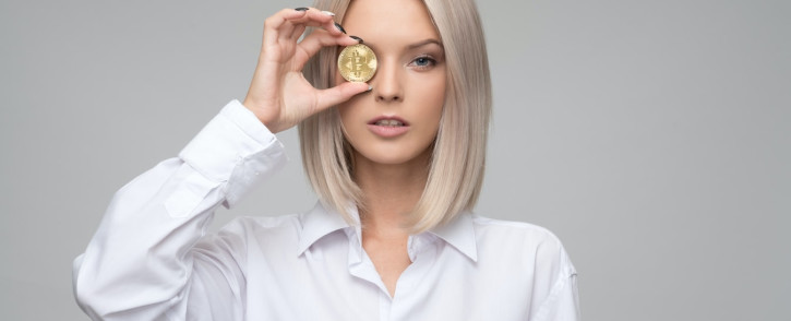 Woman with bitcoin. Credit: @icons8