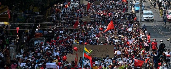 Protesters march during a demonstration against the military coup in Yangon on 7 February 2021. Picture: AFP